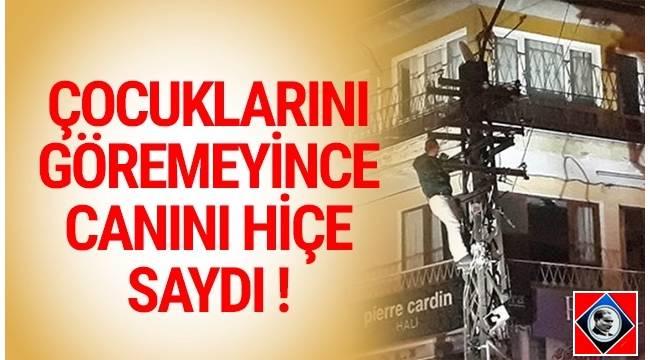 Ankara'da cezaevinden yeni tahliye edilen kişi, çocuklarını göremeyince elektrik direğine çıktı.